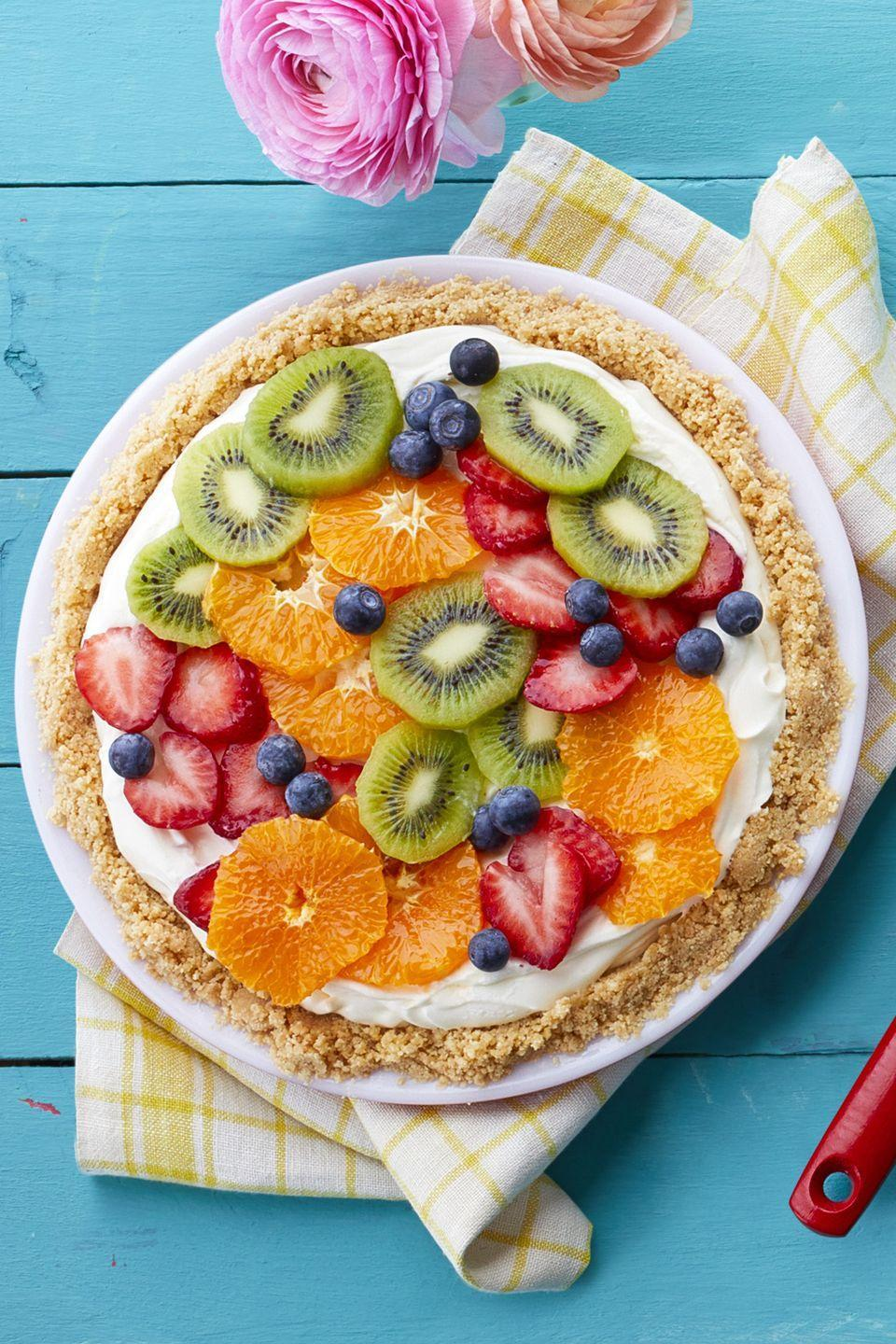 """<p>This recipe calls for clementines, blueberries, kiwi, and strawberries, but feel free to add your favorite in-season fruits to this no-bake cheesecake recipe.</p><p><u><em><strong><a href=""""https://www.womansday.com/food-recipes/food-drinks/recipes/a58994/fresh-fruit-cheesecake-pie/"""" rel=""""nofollow noopener"""" target=""""_blank"""" data-ylk=""""slk:Get the recipe for Fresh Fruit Cheesecake Pie"""" class=""""link rapid-noclick-resp"""">Get the recipe for Fresh Fruit Cheesecake Pie</a>.</strong></em></u></p>"""