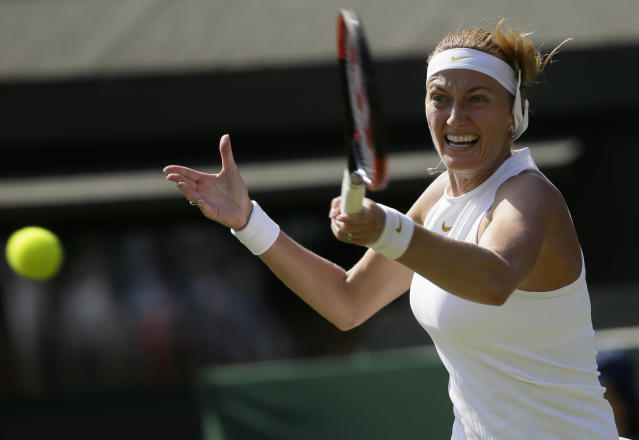 FILE - In this July 3, 2018, file photo, Petra Kvitova of the Czech Republic returns a ball to Aliaksandra Sasnovich of Belarus during their women's singles match on the second day at the Wimbledon Tennis Championships in London. Two-time Wimbledon champion Petra Kvitova said on Tuesday June 25, 2019, that she has resumed training and will decide later this week whether she's fit enough to play at the All England Club this year. (AP Photo/Tim Ireland)