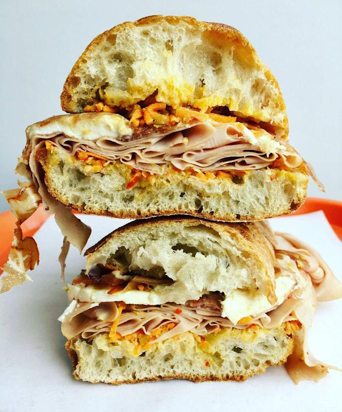 """<p><strong>Spuckie </strong></p><p>I know, what exactly is a Spuckie? Coming from Italian immigrant roots from the word spucadella, which is a type of Italian long roll. Like an Italian hero, a spuckie is made with a mix of Italian cured meats and cheeses and can be served cold or pressed. One of the most well-known can be found at <a href=""""https://www.cuttyfoods.com/"""" rel=""""nofollow noopener"""" target=""""_blank"""" data-ylk=""""slk:Cutty's"""" class=""""link rapid-noclick-resp"""">Cutty's</a> in Brookline Village which has a variety of Spuckies to choose from.</p>"""