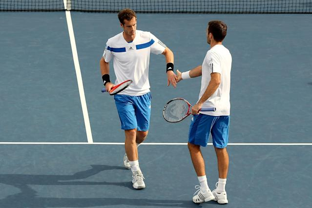 MONTREAL, QC - AUGUST 07: Andy Murray of Great Britain and Colin Fleming of Great Britain slap hands between points while playing Nenad Zimonjic of Serbia and Julien Benneteau of France during the Rogers Cup at Uniprix Stadium on August 7, 2013 in Montreal, Quebec, Canada. (Photo by Matthew Stockman/Getty Images)