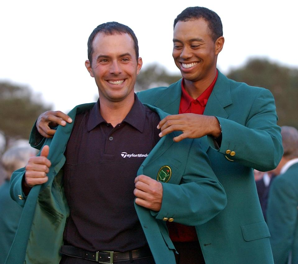 <p>2002 champion Tiger Woods, right, helps Mike Weir don the traditional green jacket after the Canadian won the 2003 Masters, at the Augusta National Golf Club in Augusta, Ga., April 13, 2003. (AP Photo/Elise Amendola) </p>
