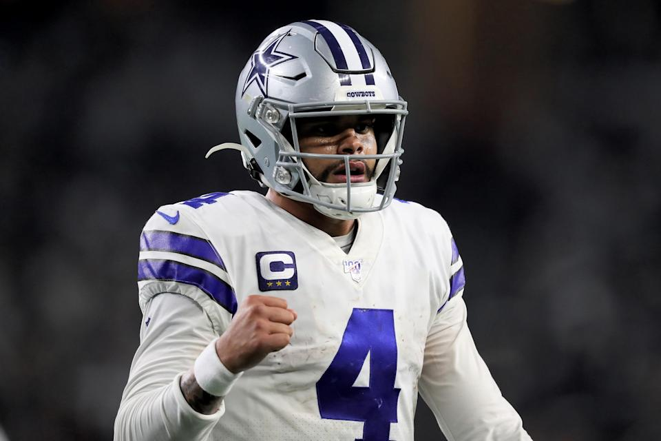 Dak Prescott doesn't have a long-term contract with the Cowboys yet, but owner Jerry Jones is building around his quarterback anyway. (Photo by Tom Pennington/Getty Images)