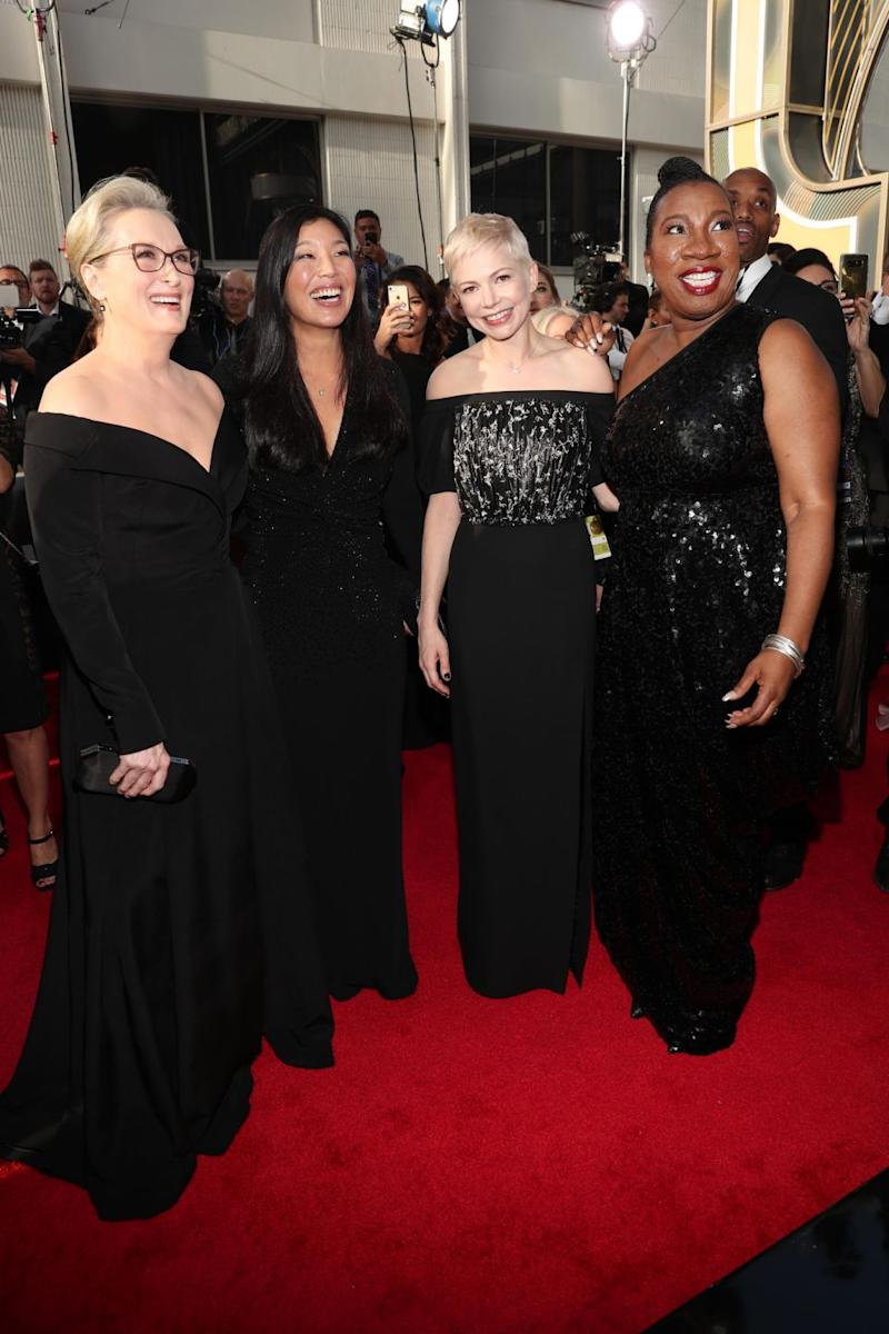 Actresses Meryl Streep and Michelle Williams with activists Ai-jen Poo and Tarana Burke. Photo: Getty