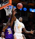 Tennessee forward Willie Carmichael III (24) and Tennessee Tech center Dwan Caldwell (32) compete for a rebound during the first half of an NCAA college basketball game in Knoxville, Tenn. on Friday, Dec. 19, 2014. (AP Photo/Knoxville News Sentinel, Adam Lau)