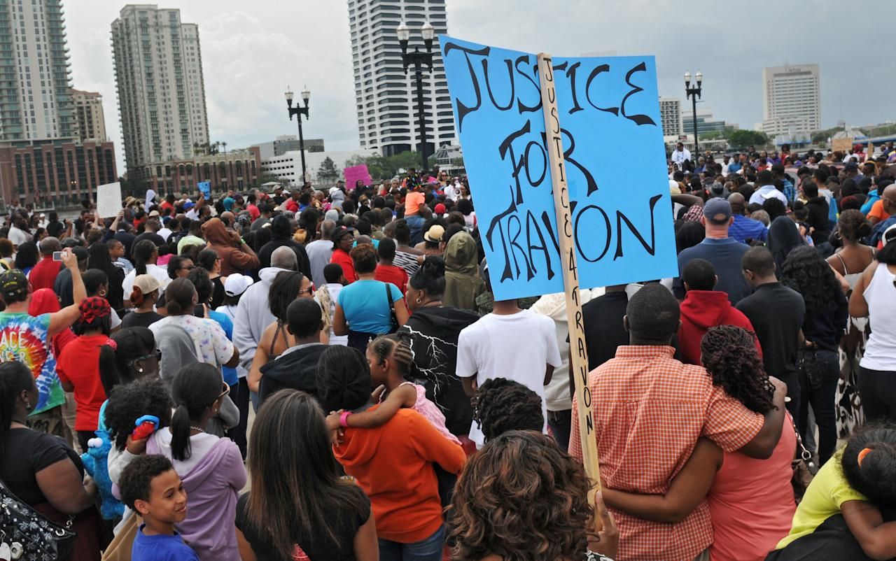 A large crowd attends a rally for Trayvon Martin on Saturday, March 24, 2012 in Jacksonville, Fla. Seventeen-year-old Trayvon Martin was killed in the town of Sanford on Feb. 26. The shooting has set off a nationwide furor over race and justice. (AP Photo/The Florida Times-Union, Bob Mack )