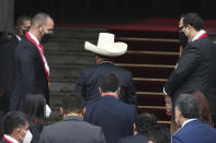 Peru's President-elect Pedro Castillo enters Congress in his signature hat to his swearing-in ceremony on his Inauguration Day in Lima, Peru, Wednesday, July 28, 2021. (AP Photo/Francisco Rodriguez)