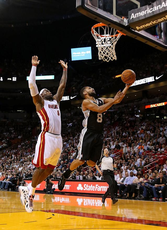 MIAMI, FL - NOVEMBER 29: LeBron James #6 of the Miami Heat chases down Patrick Mills #8 of the San Antonio Spurs during a game at American Airlines Arena on November 29, 2012 in Miami, Florida. (Photo by Mike Ehrmann/Getty Images)