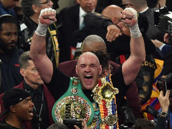 Fury celebrates his victory over Wilder (AFP)