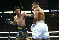 Jorge Linares, left, hits Devin Haney during a WBC lightweight title boxing match Saturday, May 29, 2021, in Las Vegas. (AP Photo/Chase Stevens)