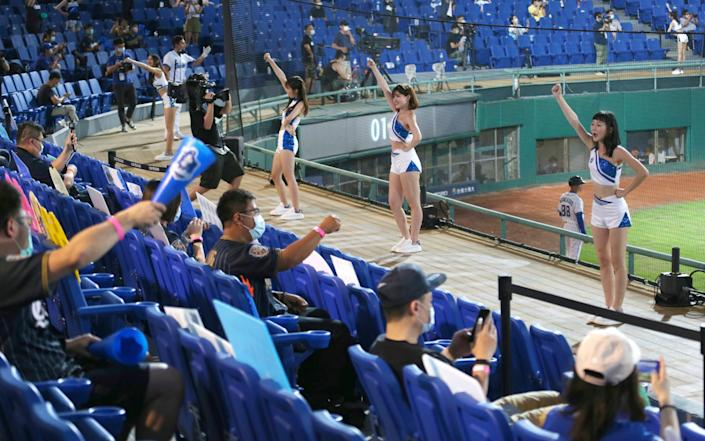 Baseball fans are slowly being allowed to return as Taiwan successfully fights the virus - Chiang Ying-ying/AP