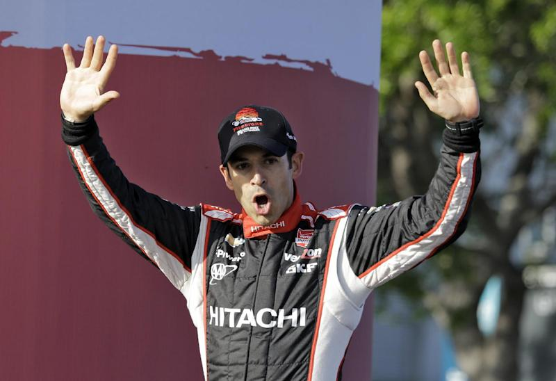 Helio Castroneves, of Brazil, waves to the fans after finishing third in the IndyCar Grand Prix of St. Petersburg auto race, Sunday, March 30, 2014, in St. Petersburg, Fla. (AP Photo/Chris O'Meara)