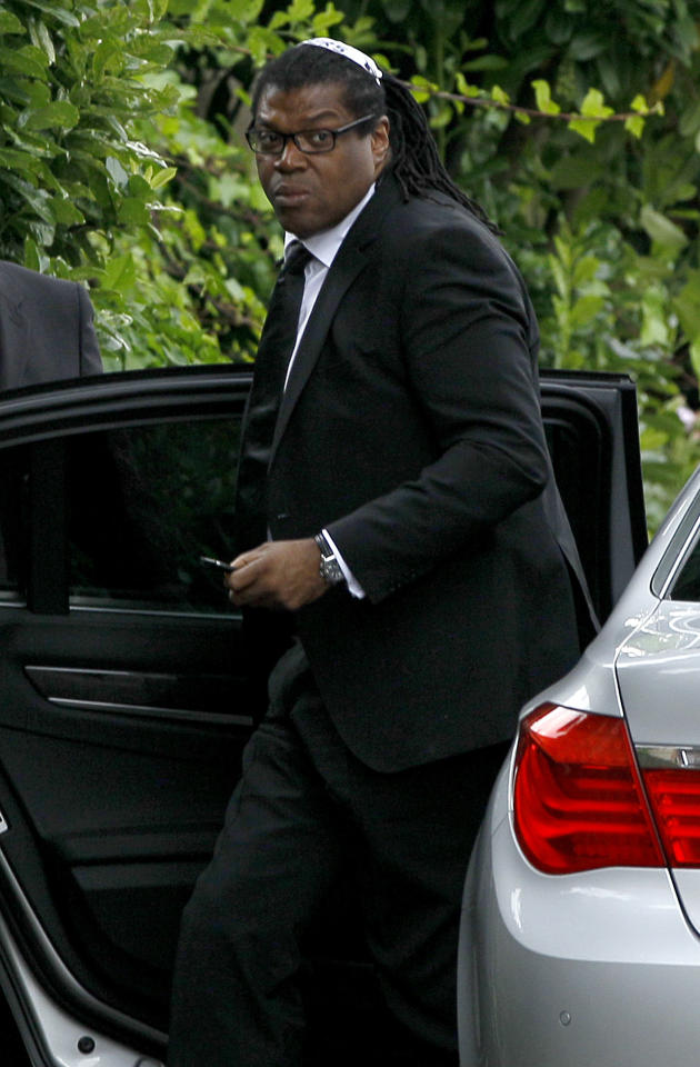 Manager Raye Cosbert arrives at Southgate progressive Synagogue for the funeral ceremony of British singer Amy Winehouse, London, Tuesday, July 26, 2011. Winehouse, who had battled alcohol and drug addiction, was found dead Saturday at her London home. She was 27. (AP Photo/Kirsty Wigglesworth)