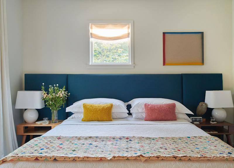 The other guest room also has a bed by Ballard Designs, which is flanked by vintage Russel Wright tables.