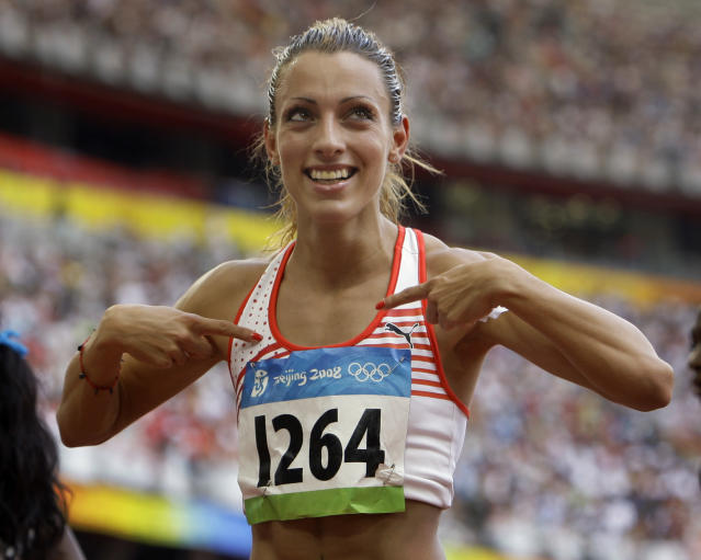 Ivet Lalova of Bulgaria reacts after running in the women's 100m heats during the athletics competitions in the National Stadium at the Beijing 2008 Olympics in Beijing, Saturday, Aug. 16, 2008. (AP Photo/Anja Niedringhaus)