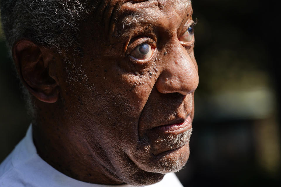 Bill Cosby reacts outside his home in Elkins Park, Pa., Wednesday, June 30, 2021, after being released from prison. Pennsylvania's highest court has overturned comedian Cosby's sex assault conviction. The court said Wednesday, that they found an agreement with a previous prosecutor prevented him from being charged in the case. The 83-year-old Cosby had served more than two years at the state prison near Philadelphia and was released.(AP Photo/Matt Rourke)