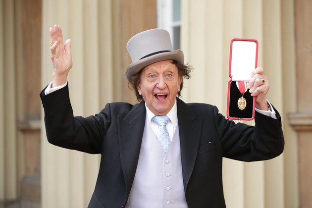Ken Dodd after being knighted by Prince William last year.