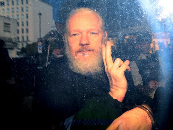 Julian Assange inside a police vehicle on his arrival at Westminster Magistrates' Court last week. (Getty Images)