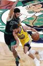 Golden State Warriors' Stephen Curry (30) drives past Boston Celtics' Jayson Tatum (0) during the second half of an NBA basketball game, Saturday, April 17, 2021, in Boston. (AP Photo/Michael Dwyer)