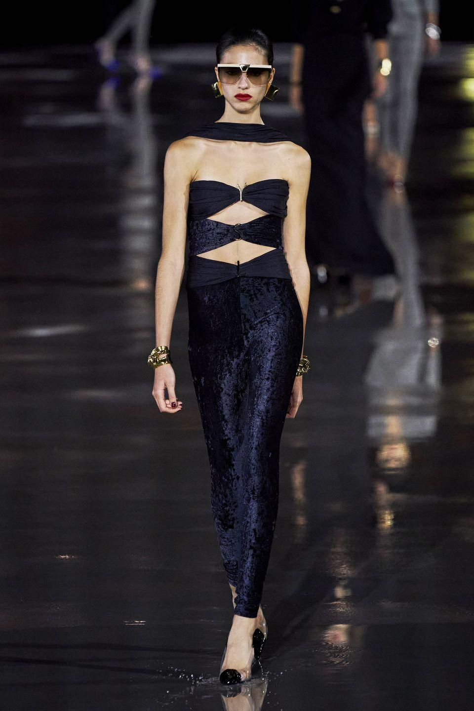 """<p>The spring/summer 2022 Saint Laurent collection referenced a """"fundamental yet not well-known moment"""" in Pierre Bergé's career, one which led him down a new artistic path. </p><p>This moment was summed up in a quote: """"We were invited to a friend's house who was throwing a party. At one point, I no longer spot Yves. I look for him and find him with a young unknown girl. She had wedge heels, a turban on her head, and things she had tinkered into clothes. It was Paloma Picasso.""""</p><p> The collection paid tribute then to Paloma Picasso's independence of spirit: """"Her freedom, her instincts, her energy which let her breathe freely....A celebration of a woman who is singular in every way, effortlessly inventive in every aspect of her appearances, always projecting a studied nonchalance. She thrillingly unsettles with her way of associating the masculine with the glamourous.""""</p>"""