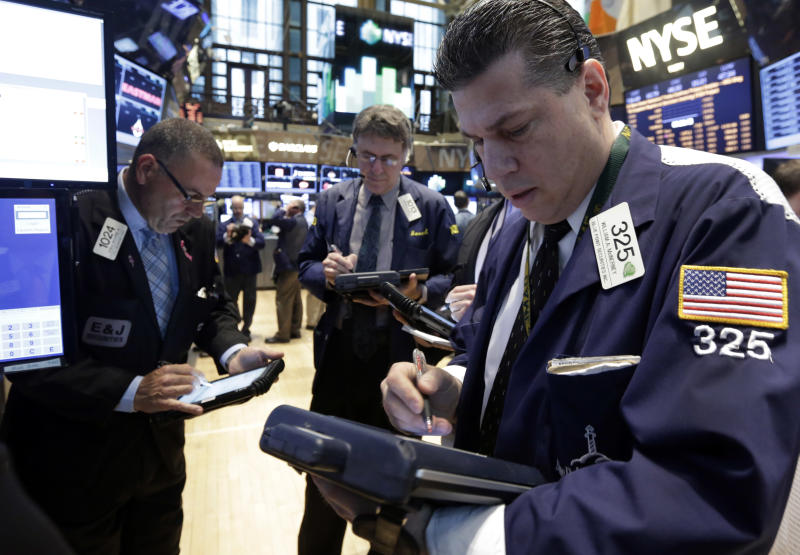 Trader William McInerney works on the floor of the New York Stock Exchange Wednesday, April 23, 2014. A six-day rally on the stock market is petering out as some U.S. companies report earnings that disappoint investors. (AP Photo/Richard Drew)