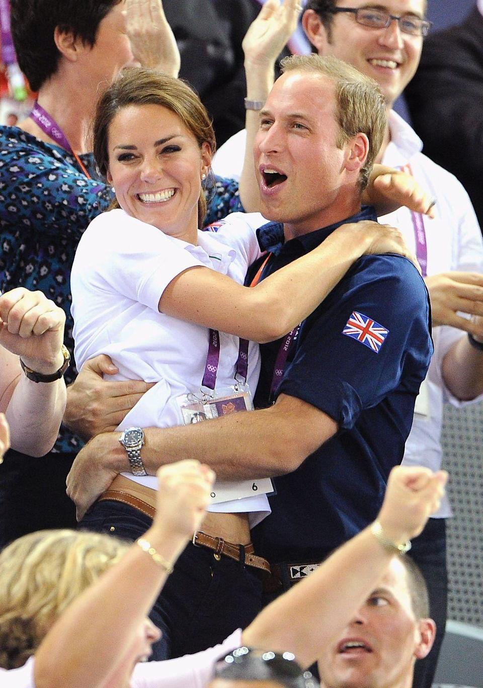 <p>In an unusual display of public affection, the Duke and Duchess of Cambridge embraced each other while celebrating the 2012 Olympic Games in London.</p>