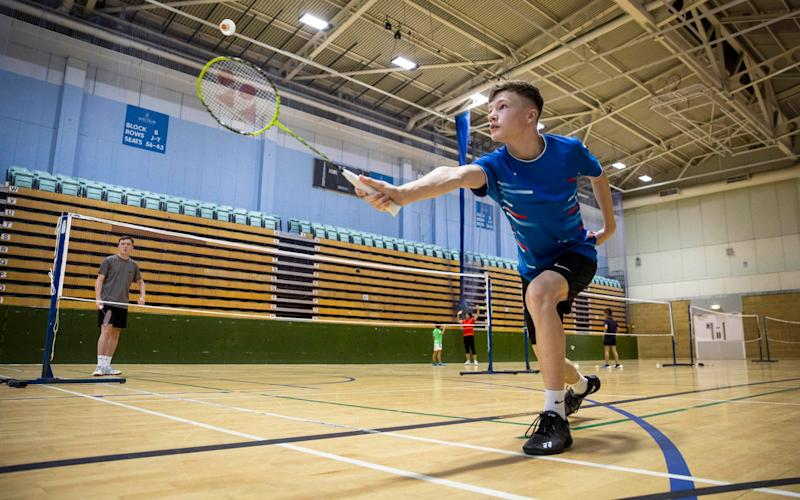Badminton player, Dylan Saunders (aged 15) from Winchester enjoys getting back on court during an Indoor Sports Collective Day - PA