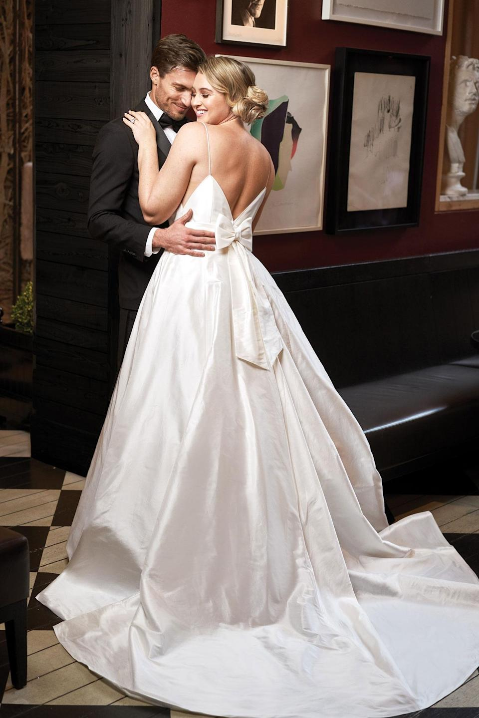 <p>Lawrence wears a voluminous white full-skirt gown with back bow detail by Justin Alexander. (Photo: courtesy of Justin Alexander) </p>