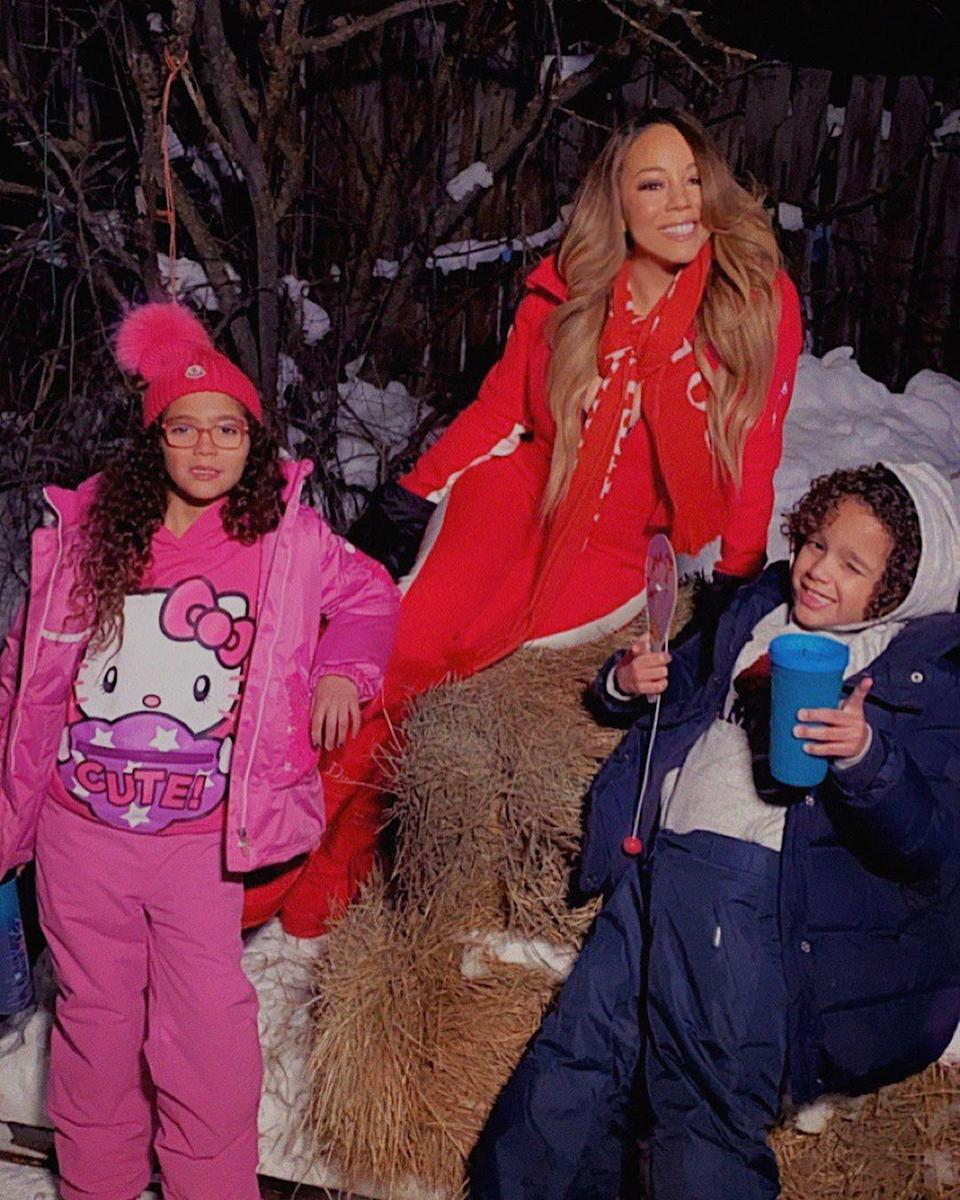 """<p><a href=""""https://people.com/tag/mariah-carey/"""" rel=""""nofollow noopener"""" target=""""_blank"""" data-ylk=""""slk:Mariah Carey"""" class=""""link rapid-noclick-resp"""">Mariah Carey</a> is having double the fun with being a mom with her twins.</p> <p>The """"All I Want for Christmas"""" singer is the mother to fraternal twins<a href=""""https://people.com/parents/mariah-carey-nick-cannon-welcome-twins/"""" rel=""""nofollow noopener"""" target=""""_blank"""" data-ylk=""""slk:Monroe and Moroccan"""" class=""""link rapid-noclick-resp""""> Monroe and Moroccan</a>, 10, who she co-parents with ex-husband <a href=""""https://people.com/tag/nick-cannon/"""" rel=""""nofollow noopener"""" target=""""_blank"""" data-ylk=""""slk:Nick Cannon"""" class=""""link rapid-noclick-resp"""">Nick Cannon</a>. In her 2020 memoir, <a href=""""https://people.com/music/mariah-carey-complicated-relationship-mother-patricia/"""" rel=""""nofollow noopener"""" target=""""_blank"""" data-ylk=""""slk:The Meaning of Mariah Carey"""" class=""""link rapid-noclick-resp""""><i>The Meaning of Mariah Carey</i></a>, the singer wrote about providing a life for her children that would be vastly different than her upbringing. </p> <p>While five-time Grammy winner came from a childhood of instability, Queen Mariah is making sure her children live a life fit for royalty. </p> <p>""""Rather than being uprooted 13 times, they live in multiple gorgeous, pristine, and palatial homes,"""" she wrote. """"Instead of exposed nails in the stairs and filthy carpeting, they run freely down long, shiny marble hallways, slide in their socks, and squeal with delight. In lieu of a three-legged rocking couch, they watch films on a cinema-style screen from a steady, luxurious custom-made one of goose-down cushions that's bigger than my first apartment.""""</p>"""