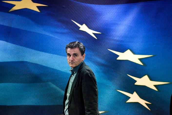 Newly appointed Greek Finance Minister Euclid Tsakalotos arrives for a handover ceremony at the Finance Ministry in Athens on July 6, 2015 (AFP Photo/Angelos Tzortzinis)