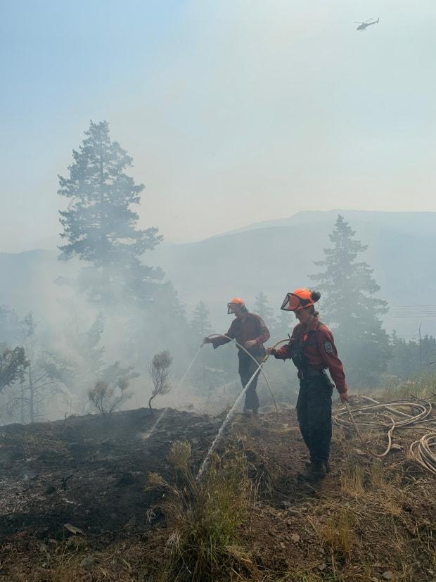 Firefighters with the BC Wildfire Service put out hot spots on the McKay Creek wildfire, north of Lillooet. (BC Wildfire Service - image credit)