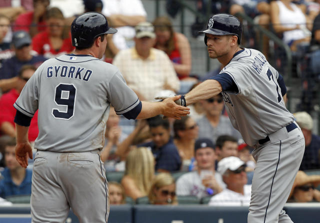 San Diego Padres' Chase Headley celebrates with Jedd Gyorko at home plate after hitting a home run in the sixth inning of a baseball game against the Atlanta Braves at Turner Field on Sunday, Sept. 15, 2013, in Atlanta. (AP Photo/Butch Dill)