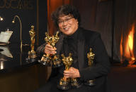 <p>Parasite also won best international feature film and the biggest award of the night, best picture, becoming the first film not in the English language to take home the prize. Bong Joon Ho will present at the 2021 Oscars ceremony. (Richard Shotwell/Invision/AP)</p>