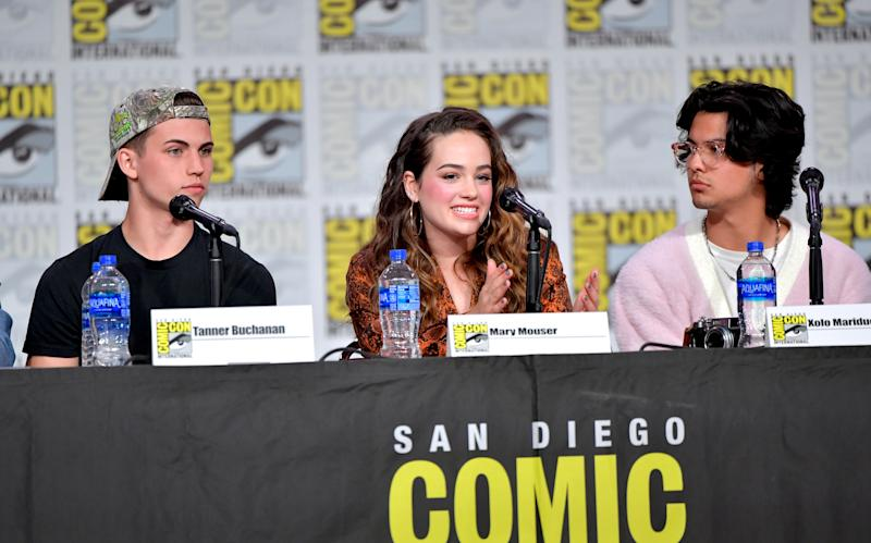 "SAN DIEGO, CALIFORNIA - JULY 18: Tanner Buchanan, Mary Mouser, and Xolo Mariduena speak at the ""Cobra Kai: Past, Present, And Future"" panel during 2019 Comic-Con International at San Diego Convention Center on July 18, 2019 in San Diego, California. (Photo by Amy Sussman/Getty Images)"