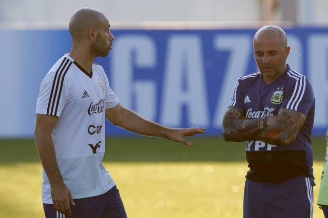 Javier Mascherano, left, talks to coach Jorge Sampaoli during a training session of Argentina at the 2018 soccer World Cup in Bronnitsy, Russia, Monday, June 18, 2018. (AP Photo/Ricardo Mazalan)