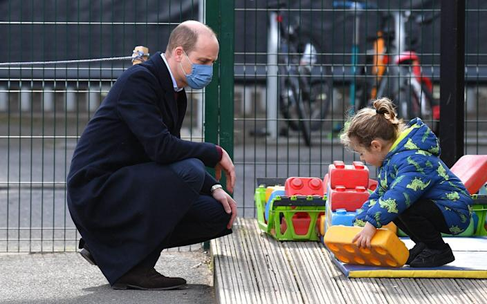 The Duke of Cambridge watches as a child plays during a visit to School21 - JUSTIN TALLIS/AFP