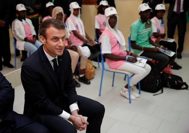 French President Emmanuel Macron visits a classroom during the inauguration of the College Bel-Air secondary schoo in Dakar, Senegal, February 2, 2018. REUTERS/Philippe Wojazer