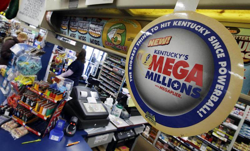 A woman buys lottery tickets at the One Stop store, Thursday, Dec. 12, 2013, in Newport, Ky. Friday's Mega Millions drawing has an estimated jackpot of $400 million. (AP Photo/Al Behrman)