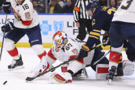 Buffalo Sabres forward Johan Larsson (22) is stopped by Florida Panthers goalie Chris Driedger (60) during the third period of an NHL hockey game Saturday, Jan. 4, 2020, in Buffalo, N.Y. (AP Photo/Jeffrey T. Barnes)