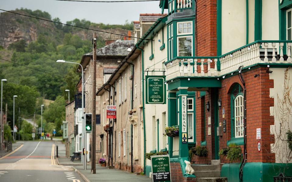 The Bradford Arms in Llanymynech, where the border for England and Wales runs along the A483 - PA
