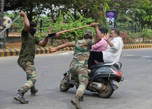 Hundreds have been injured in India during clashes between protesters and riot police wielding bamboo canes, or 'lathis'
