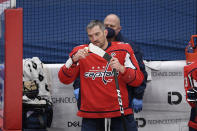 Washington Capitals left wing Alex Ovechkin (8) tapes his stick during a break in the action in the first period of the team's NHL hockey game against the Philadelphia Flyers, Tuesday, April 13, 2021, in Washington. (AP Photo/Nick Wass)
