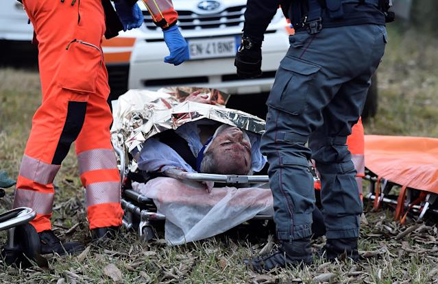 <p>An injured person lies on a stretcher after two trains derailed in Pioltello, on the outskirts of Milan, Italy, Jan. 25, 2018. (Photo: Stringer/Reuters) </p>