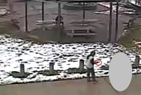 Tamir E. Rice, 12, is seen allegedly pointing a pellet gun at the Cudell Recreation Center in Cleveland, Ohio, in this still image from video released by the Cleveland Police Department November 26, 2014. REUTERS/Cleveland Police Department/Handout via Reuters