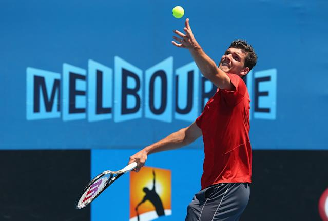 MELBOURNE, AUSTRALIA - JANUARY 14: Frank Dancevic of Canada serves in his first round match against Benoit Paire of France during day two of the 2014 Australian Open at Melbourne Park on January 14, 2014 in Melbourne, Australia. (Photo by Robert Prezioso/Getty Images)