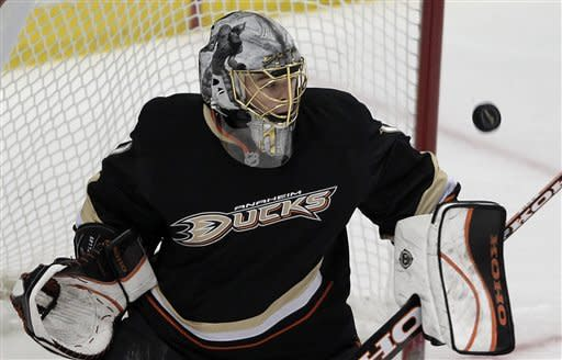 Anaheim Ducks goalie Jonas Hiller looks at the puck hit by the Phoenix Coyotes in the third period of an NHL hockey game in Anaheim, Calif., Wednesday, Jan. 18, 2012. The Ducks won 6-2. (AP Photo/Jae C. Hong)