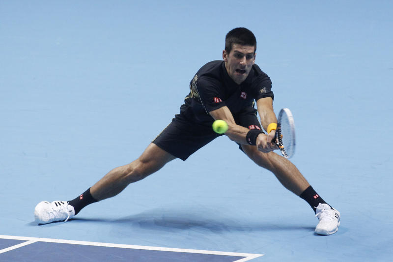 Novak Djokovic of Serbia plays a return to Andy Murray of Britain during their ATP World Tour Finals singles tennis match at the O2 Arena in London, Wednesday, Nov. 7, 2012. (AP Photo/Sang Tan)