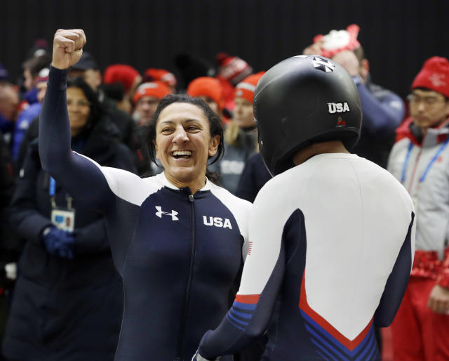 Driver Elana Meyers Taylor, left, and Lauren Gibbs of the United States celebrate after their silver medal winning heat during the women's two-man bobsled final at the 2018 Winter Olympics in PyeongChang, South Korea, Wednesday, Feb. 21, 2018. (AP)