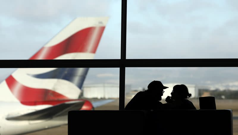 A British Airways Boeing 747 passenger aircraft prepares to take off as passengers wait to board a flight in Cape Town International airport in Cape Town