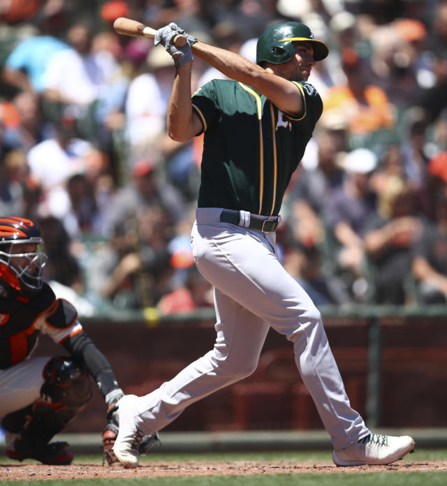 Oakland Athletics' Matt Olson swings for an RBI single off San Francisco Giants' Andrew Suarez in the fourth inning of a baseball game Sunday, July 15, 2018, in San Francisco. (AP Photo/Ben Margot)