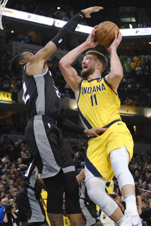 Indiana Pacers forward Domantas Sabonis (11) shoots next to Sacramento Kings forward Richaun Holmes (22) during the second half of an NBA basketball game in Indianapolis, Friday, Dec. 20, 2019. The Pacers won 119-105. (AP Photo/AJ Mast)